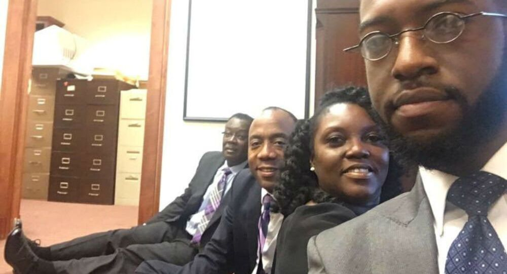 Benard Simelton (L), president of the Alabama NAACP State Conference, Cornell William Brooks (2nd L), president & CEO of the National Association for the Advancement of Colored People (NAACP), and Devon Crawford (R), a fellow with with the NAACP Youth & College Division, occupy the office of Jeff Sessions, US President-elect Donald Trump's pick for for attorney general, in Mobile, Alabama, January 3, 2017