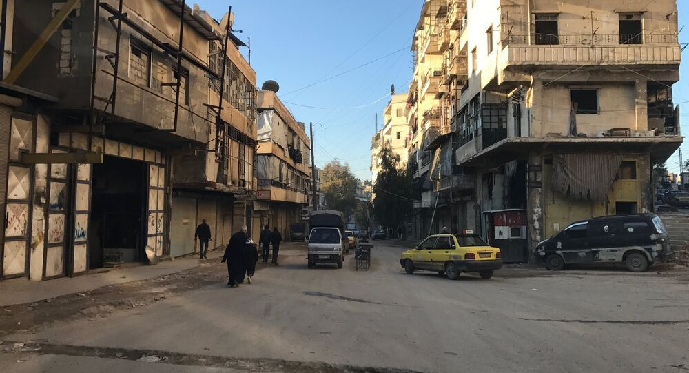 Residents in al-Midan neighborhood in Syria's Aleppo