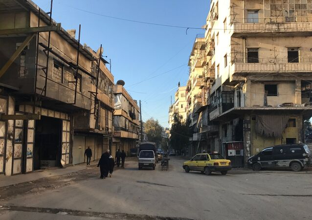 Residents in al-Midan neighborhood in Syria's Aleppo