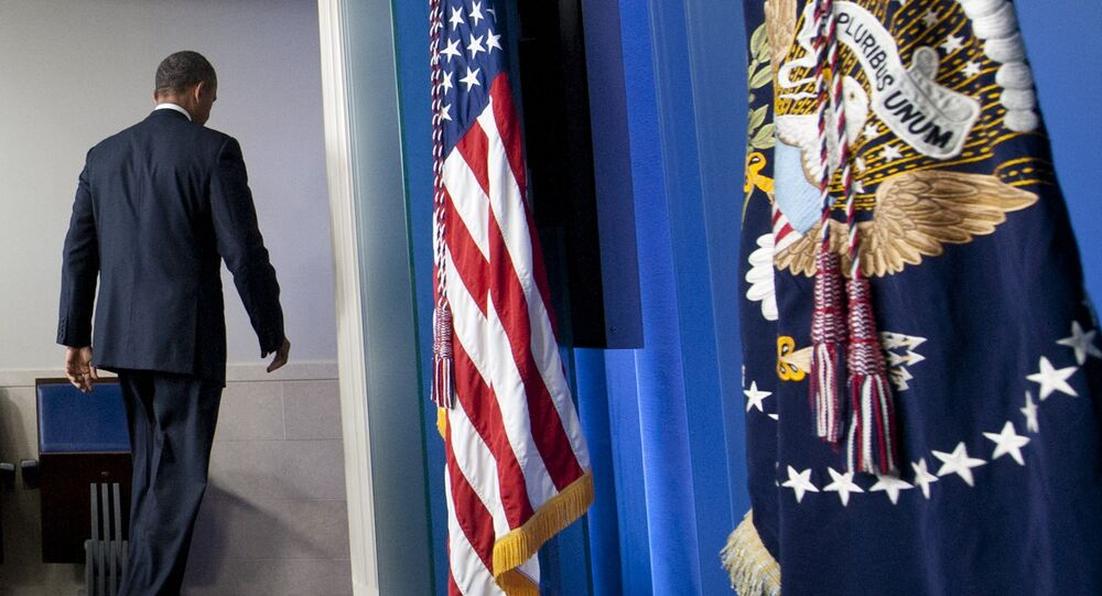 US President Barack Obama leaves after speaking about the possible government shutdown during a budget showdown with Congress in the Brady Press Briefing Room of the White House in Washington, DC, September 30, 2013