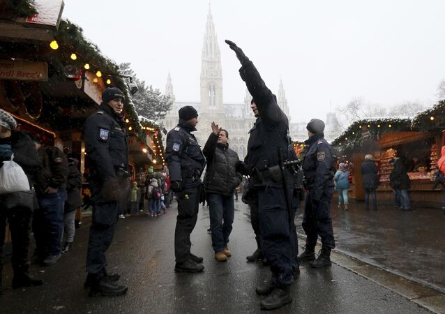 Police patrol at the Christmas market in front of the city hall in downtown Vienna, Austria, Tuesday, Dec. 20, 2016