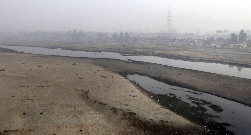 Very little water flows in the Ravi River in Lahore, Pakistan, Wednesday, Dec. 14, 2016. Under the Indus Water Treaty, India has exclusive rights to three Indus basin rivers, including the Ravi, which has virtually disappeared on the Pakistani side