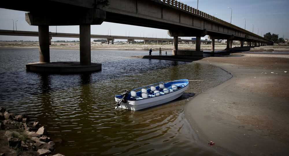 Boat floats in the almost dried-up Chenab River, Pakistan's main river which originates from India, near Gujrat, Pakistan (File)