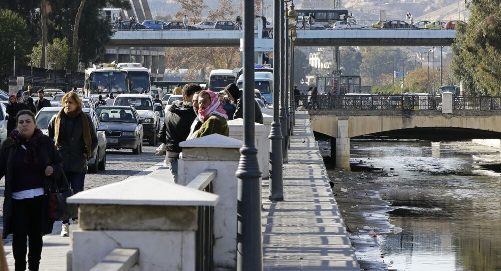 A general view shows people walking near the Barada river in the Syrian capital Damascus on January 3, 2017