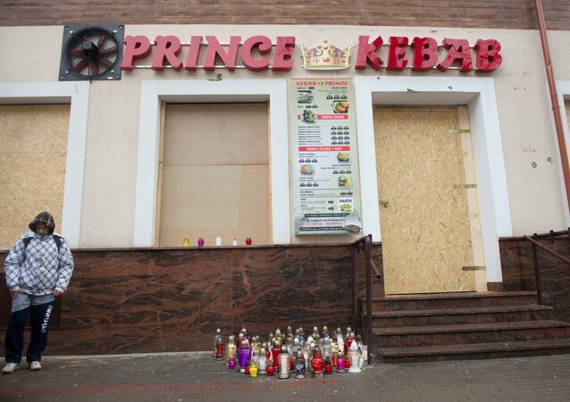 A man stands in front of the kebab shop where a 21-year old man was stabbed to death during new year's eve in a brawl with shop workers, in Elk, Poland January 2, 2017