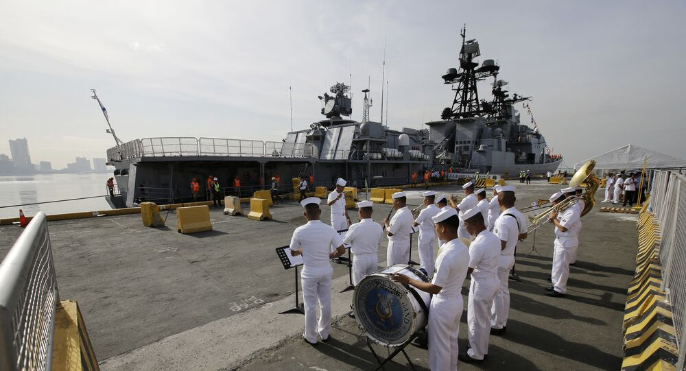 A Philippine Navy Band plays as the Russian Navy vessel Admiral Tributs, a large anti-submarine ship, docks at Manila's pier, Philippines on Tuesday, Jan. 3, 2017