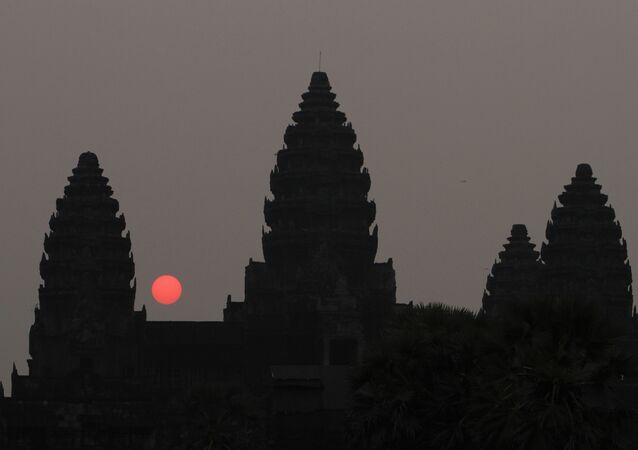 In this Friday, March 20, 2015, photo, the sun rises behind Angkor Wat at the eastern site of Siem Reap province, some 230 kilometers (143 miles) northwest of Phnom Penh, Cambodia