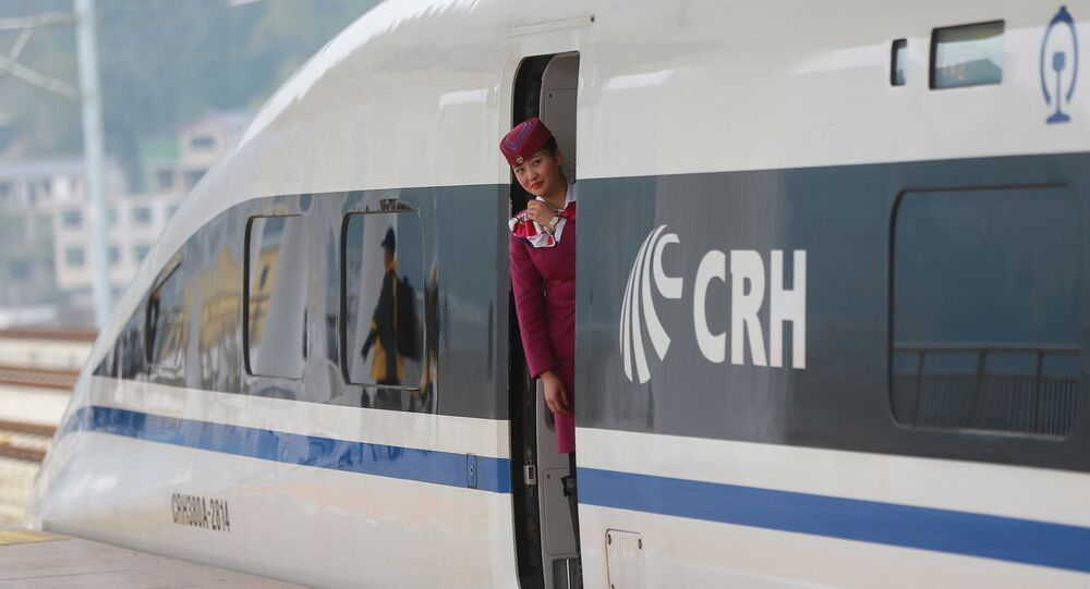 A staff looks out from a high-speed railway train linking Shanghai and Kunming, of Yunnan province, after a partial operation, in Guanling, Guizhou province, China, December 28, 2016. Picture taken December 28, 2016