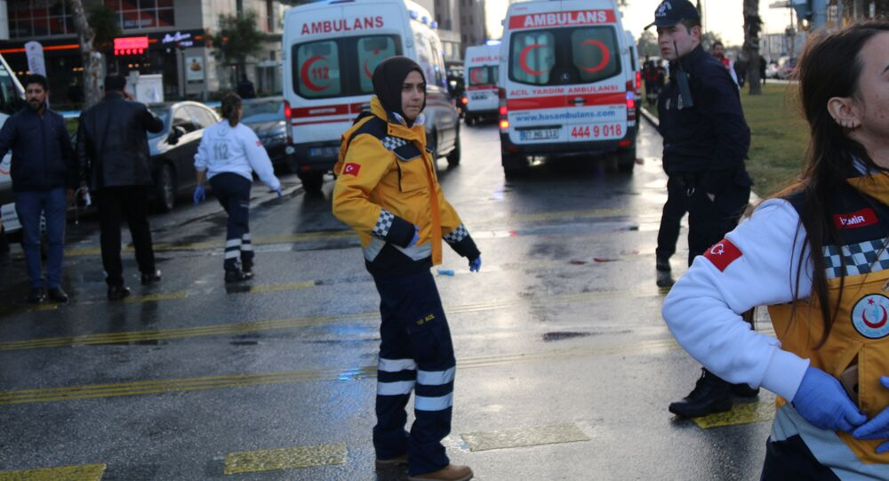 Medics arrive at the scene after an explosion outside a courthouse in Izmir, Turkey, January 5, 2017