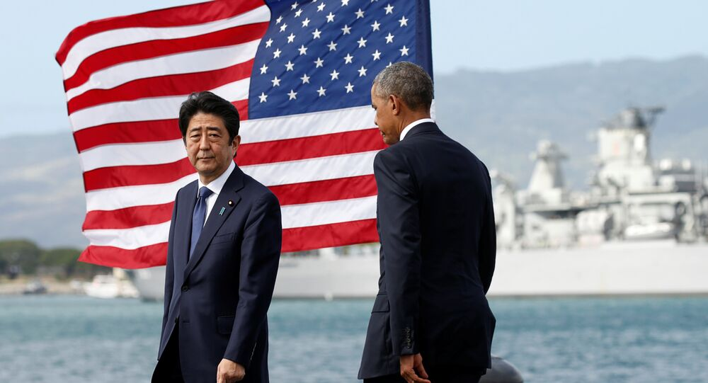Japanese Prime Minister Shinzo Abe and U.S. President Barack Obama take the stage to deliver remarks at Joint Base Pearl Harbor-Hickam, Hawaii, U.S., December 27, 2016