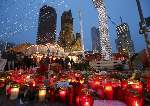 Flowers and candles are placed near the Christmas market at Breitscheid square in Berlin, Germany, December 22, 2016, following an attack by a truck which ploughed through a crowd at the market on Monday night