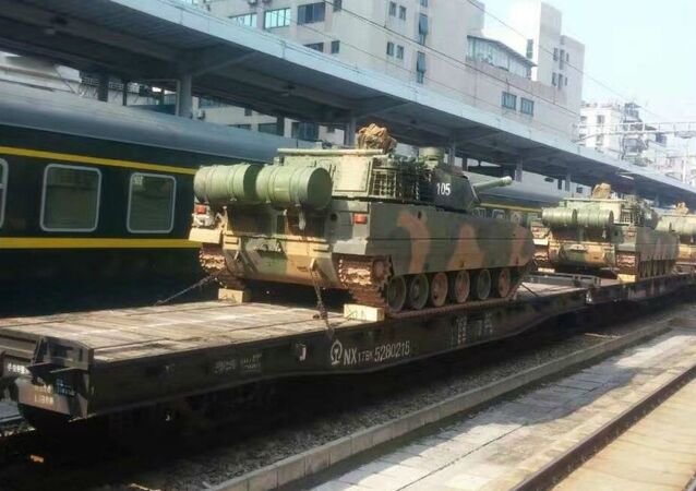 Photos of a light tank reportedly heading to a base in Southern China