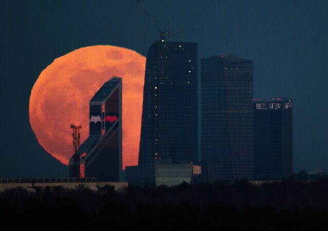 Full moon over Moscow City International Business Center