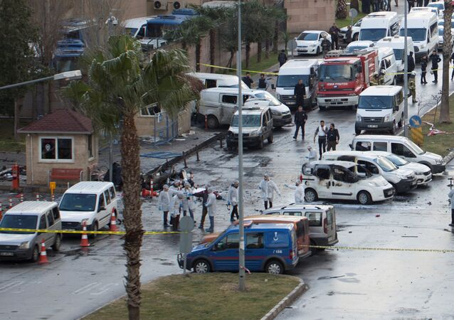 Police forensic experts examine the scene after an explosion outside a courthouse in Izmir, Turkey, January 5, 2017