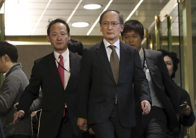 Japanese Ambassador to South Korea Yasumasa Nagamine, center, leaves after a meeting at the Foreign Ministry in Seoul, South Korea, Friday, Jan. 6, 2017