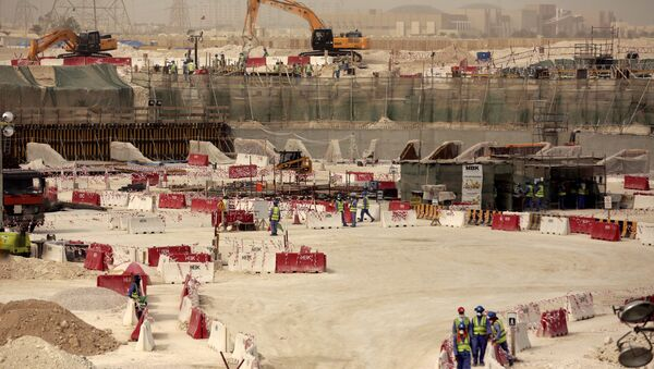 Laborers work at the Al-Wakra Stadium that is under construction for the 2022 World Cup, in Doha, Qatar (File) - Sputnik International