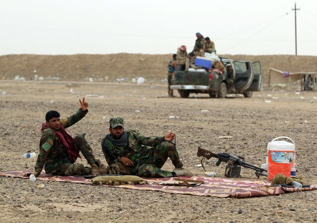 Iraqi Shiite fighters from the Popular Mobilization units rest on the Tharthar frontline on the edge of Anbar province, 120 kms northwest of Baghdad, on June 1, 2015.