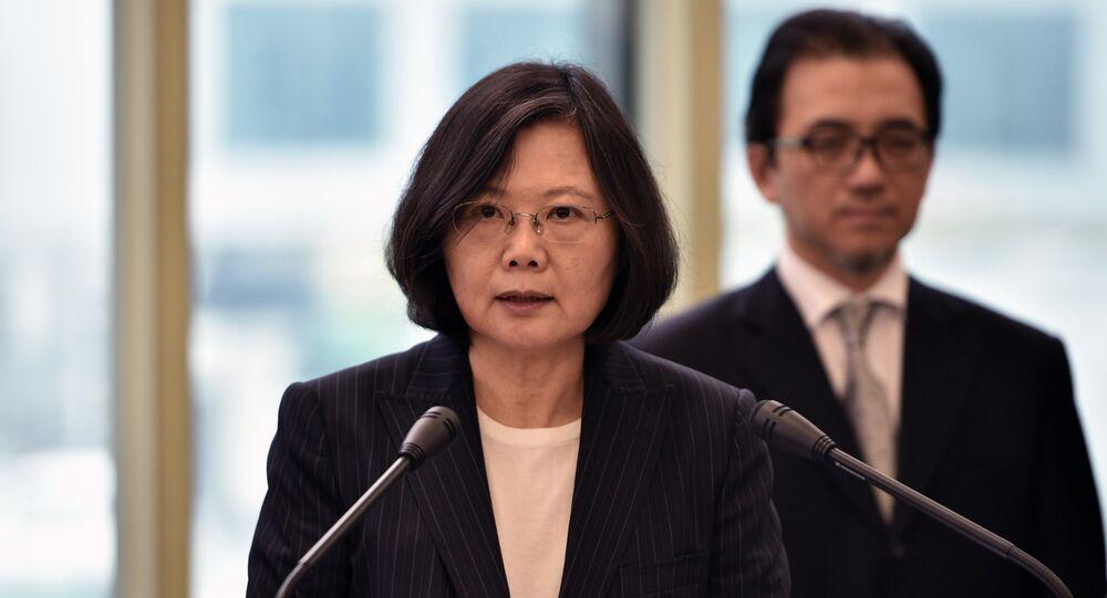 Taiwan President Tsai Ing-wen (L) speaks departing from Taoyuan airport