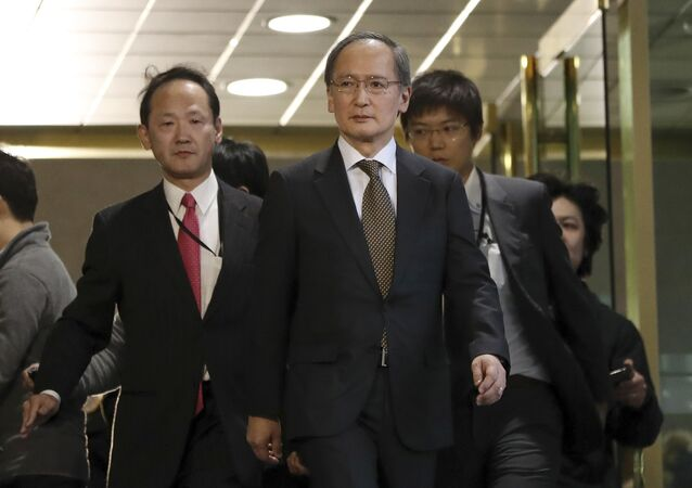 Japanese Ambassador to South Korea Yasumasa Nagamine, center, leaves after a meeting at the Foreign Ministry in Seoul, South Korea, Friday, Jan. 6, 2017.