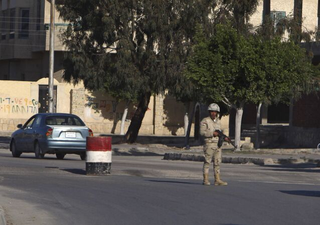 An Egyptian soldier mans a checkpoint in el-Arish, 290 kilometers (180 miles) east of Cairo, North Sinai, Egypt, Saturday, Jan. 31, 2015.