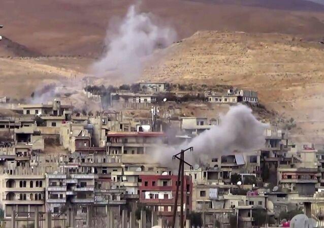 Smoke rise from shelling on Wadi Barada, northwest of Damascus, Syria