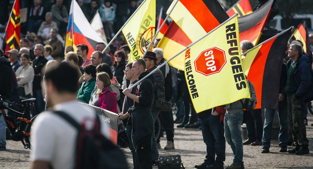 Supporters of the anti-immigrant Pegida movement (Patriotic Europeans Against the Islamisation of the Occident) mark the second year of existence as they demonstrate in Dresden, eastern Germany, on October 2016.