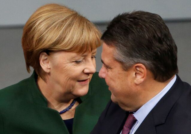 German Chancellor Angela Merkel and Economy Minister Sigmar Gabriel attend a meeting at the lower house of parliament Bundestag on 2017 budget in Berlin, Germany, November 23, 2016.