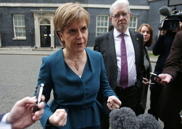 Scottish First Minister Nicola Sturgeon gestures as she speaks to members of the media outside 10 Downing Street in central London on October 24, 2016 after holding talks with British Prime Minister Theresa May and the first ministers of Wales and Northern Ireland on the government's Brexit plans. Sturgeon, leader of the secessionist Scottish National Party,