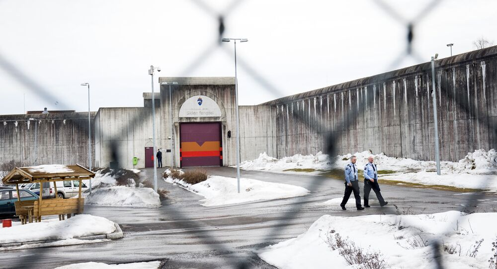 Prison guards walk on March 14, 2016 outside Skien prison, some 130 km south west of Oslo, where Norwegian mass killer Anders Behring Breivik has been serving his sentence since September 2013.