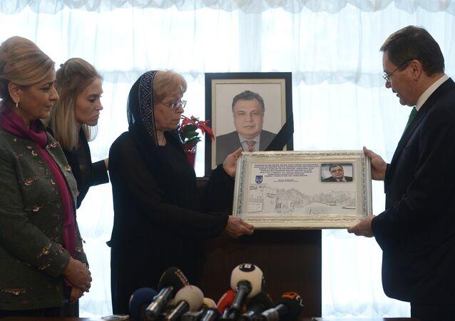 Ankara Mayor Melih Gokcek presents a certificate of renaming an Ankara street into Andrei Karlov Street to Karlov's widow.
