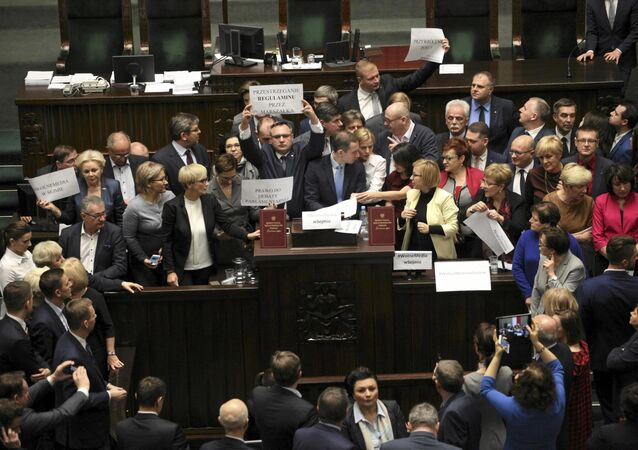 Polish opposition parliamentarians protest against the rules proposed by the head office of the Sejm, the lower house of parliament, ban all recording of parliamentary sessions except by five selected television stations and limits the number of journalists allowed in the building, in the Parliament in Warsaw, Poland December 16, 2016