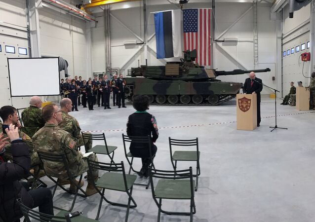 U.S. Ambassador to Estonia James D. Melville Jr. addresses dignitaries in front of an U.S. Army tank, at a hand-over ceremony of the upgraded NATO military base in Tapa, Estonia, Thursday, Dec. 15, 2016