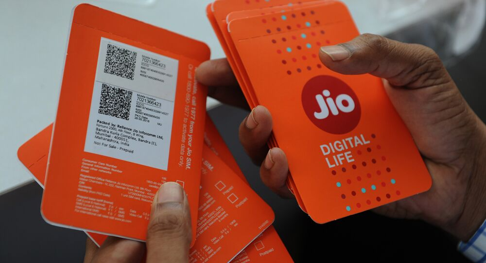 A customer selects his number of Reliance Jio Infocomm 4G mobile services in Mumbai on 6 September 2016