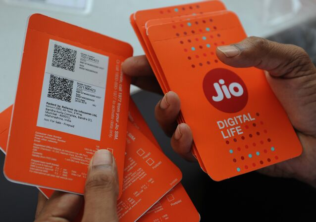 A customer selects his number of Reliance Jio Infocomm 4G mobile services in Mumbai on September 6, 2016