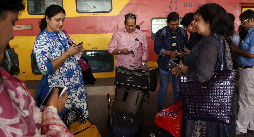 Indian travellers use a free WiFi service to browse the net at Mumbai Central Train Station in Mumbai, India, Friday, Jan. 22, 2016