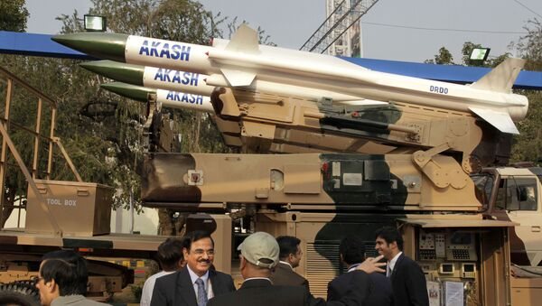 Visitors discuss in front of Defence Research & Development Organization's Akash medium range surface to air missile system, at the DefExpo-India 2010 , in New Delhi, India, Tuesday, Feb. 16, 2010 - Sputnik International