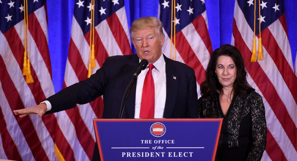 US President-elect Donald Trump gives a press conference with his Attorney Sheri Dillon (R) January 11, 2017 in New York
