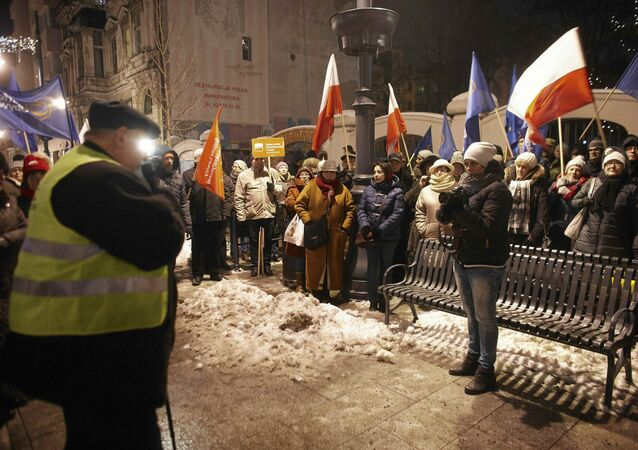 Demonstrators gather outside the Parliament building during a protest in Warsaw, Poland, January 11, 2017