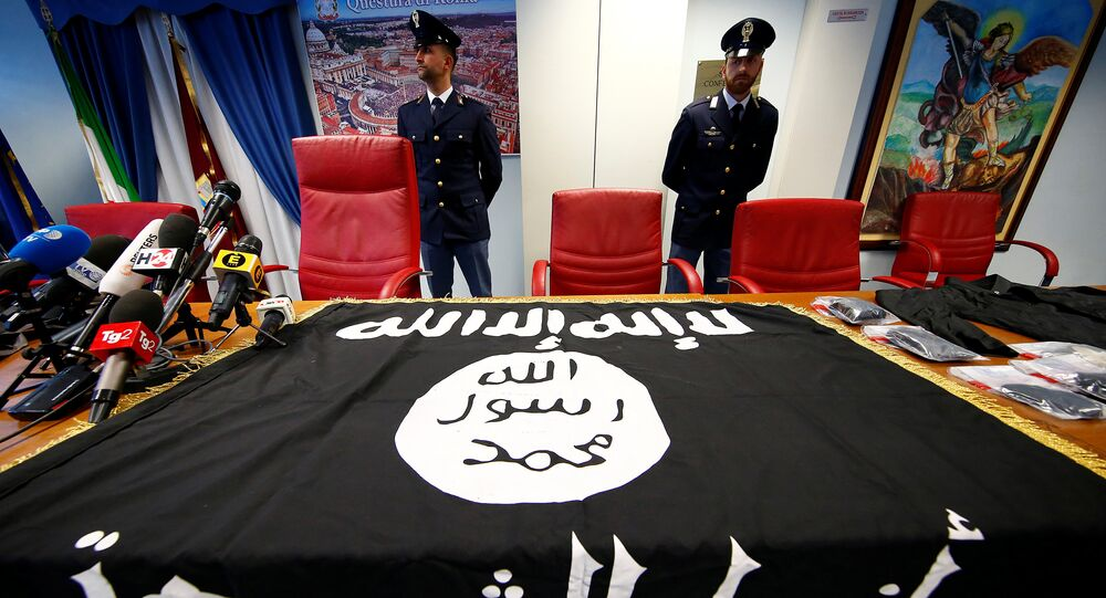 Police officers stand next to a black Islamic State flag that was seized in a raid, at a news conference held at the police headquarters in Rome, Italy, January 10, 2017