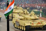 Indian military personnel drive Indian Army tanks as they take part in the Republic Day parade in New Delhi on January 26, 2014
