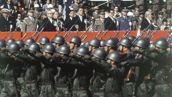 Japan's ground self-defense forces military parade goes past a reviewing stand during the defense force's annual parade in Asaka, Saitama prefecture, north of Tokyo, Oct. 30, 1983 - Sputnik International
