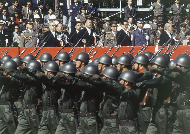 Japan's ground self-defense forces military parade goes past a reviewing stand during the defense force's annual parade in Asaka, Saitama prefecture, north of Tokyo, Oct. 30, 1983