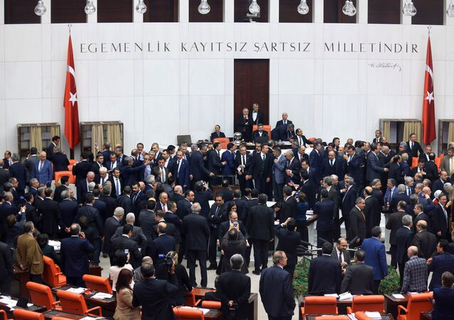 Turkish lawmakers cast their votes during a debate for a proposal for change in the constitution on January 10, 2017 at the Turkish parliament in Ankara. Turkey's parliament on January 9, 2017 began debating a controversial new draft constitution aimed at expanding the powers of the presidency under Recep Tayyip Erdogan