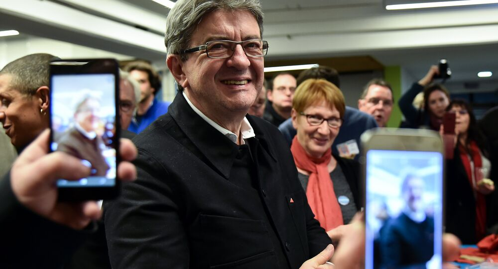 Supporters take pictures with their mobile phone of candidate of the far left coalition La France insoumise for the 2017 France's presidential elections, Jean-Luc Melenchon (C), at the end a public meeting, on January 11, 2017, in Le Mans, northwestern France