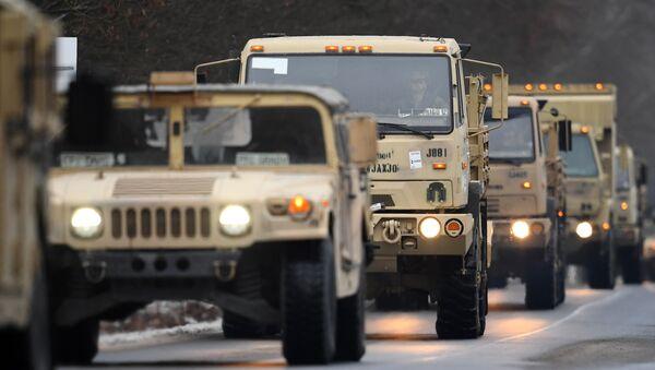 US military vehicles make their way on an army training camp near Brueck, northeastern Germany, on January 11, 2017 - Sputnik International