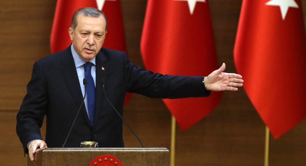 Turkish President Recep Tayyip Erdogan delivers a speech during the 31st Mukhtars (local administrators) meeting at Presidential Complex in Ankara on December 7, 2016.