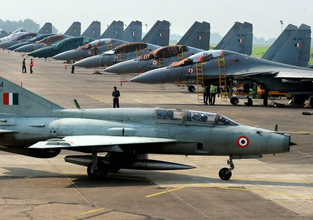 An Indian Air Force (IAF) MIG-21 passes near Sukhoi-30 fighter jets before a drill for Air Force Day celebrations in Kalikunda IAF airbase around 170 km west of Kolkata on September 29, 2011