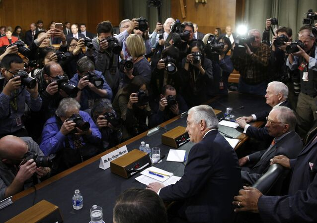 Rex Tillerson (C), former chairman and chief executive officer of Exxon Mobil, is seated prior to testifying before a Senate Foreign Relations Committee confirmation hearing on his nomination to be U.S. secretary of state, on Capitol Hill in Washington, U.S. January 11, 2017