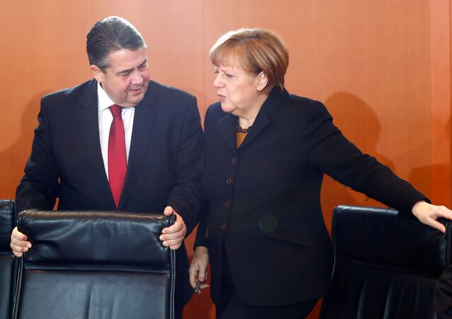 German Economy Minister Sigmar Gabriel and Chancellor Angela Merkel attend a cabinet meeting at the Chancellery in Berlin, Germany, January 11, 2017
