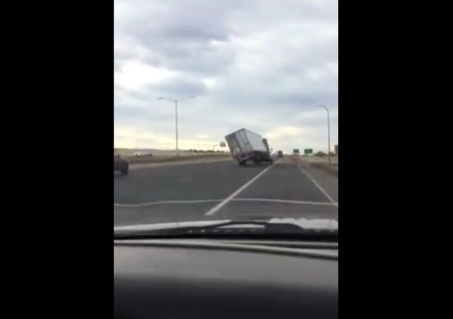 Highway Truck Topples (80+ mph winds)